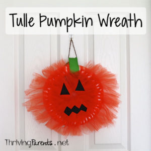 This tulle pumpkin wreath was a fun craft for our kids. It helped to develop their small motor skills and allowed them to use their creativity.