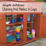 This Simple Solution for storing kid plates and cups will give your kids a chance to be more independent & helpful and will make your life easier.